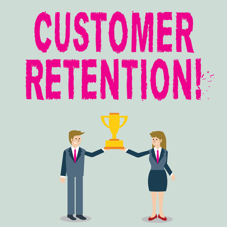 Word writing text Customer Retention. Business photo showcasing Actions or activities companies take to retain customers Man and Woman in Business Suit Holding Together the Championship Trophy Cup 免版税图像