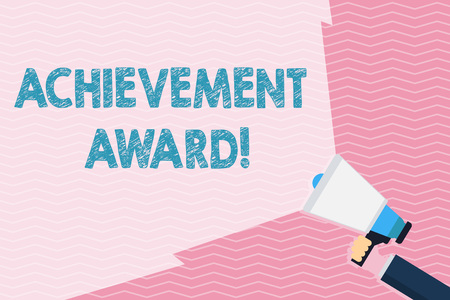 Writing note showing Achievement Award. Business concept for recognizes worthy and outstanding achievement in job skill Hand Holding Megaphone with Beam Extending the Volume Range 版權商用圖片