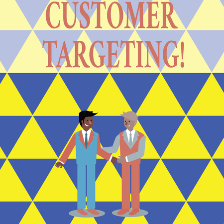 Text sign showing Customer Targeting. Business photo showcasing business process that defines which customers to market Two Businessmen Standing, Smiling and Greeting each other by Handshaking