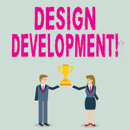 Word writing text Design Development. Business photo showcasing technical aspects of materials and building systems Man and Woman in Business Suit Holding Together the Championship Trophy Cup 免版税图像