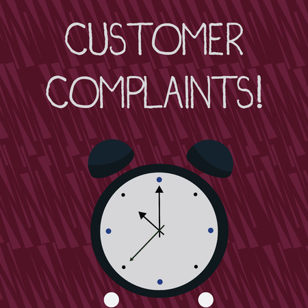 Writing note showing Customer Complaints. Business concept for expression of dissatisfaction on a consumer is behalf Colorful Round Analog Two Bell Alarm Desk Clock with Seconds Hand photo