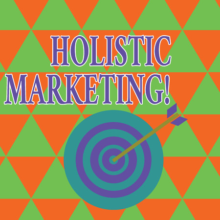 Text sign showing Holistic Marketing. Business photo showcasing developed by thinking about the business as a whole Color Dart Board in Concentric Style with Arrow Hitting the Center Bulls Eye 스톡 콘텐츠