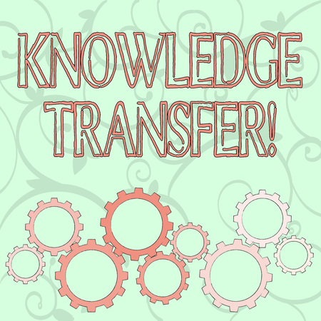Writing note showing Knowledge Transfer. Business concept for sharing or disseminating of knowledge and experience Colorful Cog Wheel Gear Engaging, Interlocking and Tesselating 免版税图像