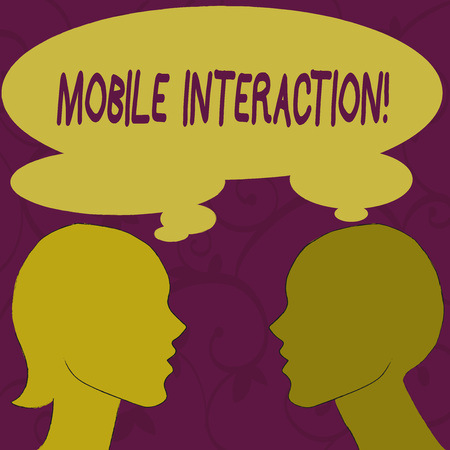Text sign showing Mobile Interaction. Business photo showcasing the interaction between mobile users and computers Silhouette Sideview Profile Image of Man and Woman with Shared Thought Bubble
