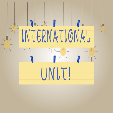 Writing note showing International Unit. Business concept for the internationally accepted amount of a substance Strip Size Lined Paper Sheet Hanging Using Blue Clothespin