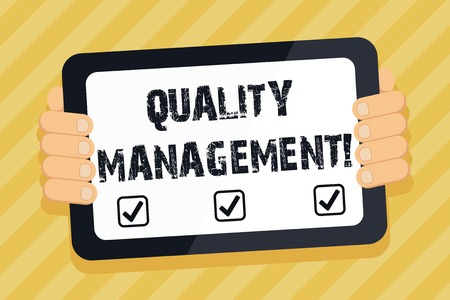 Text sign showing Quality Management. Business photo text overseeing and maintain a desired level of excellence Color Tablet Smartphone with Blank Screen Handheld from the Back of Gadget Reklamní fotografie