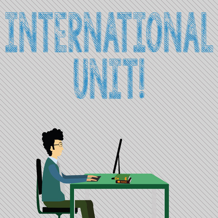 Text sign showing International Unit. Business photo showcasing the internationally accepted amount of a substance Businessman Sitting Straight on Chair Working on Computer and Books on Table
