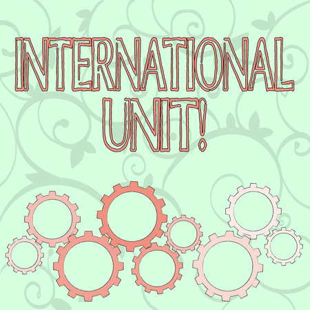 Writing note showing International Unit. Business concept for the internationally accepted amount of a substance Colorful Cog Wheel Gear Engaging, Interlocking and Tesselating