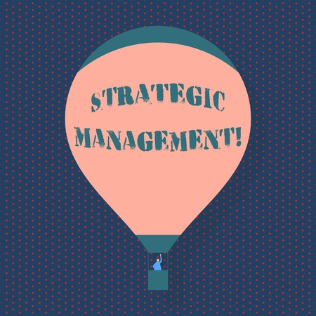 Handwriting text writing Strategic Management. Conceptual photo formulation and implementation of the major goals Blank Pink Hot Air Balloon Floating with One Passenger Waving From Gondola 스톡 콘텐츠