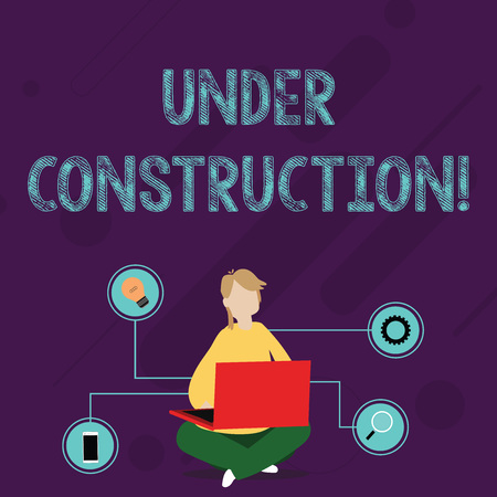 Writing note showing Under Construction. Business concept for project that is unfinished but actively being worked on Woman Sitting with Crossed Legs on Floor Browsing the Laptop