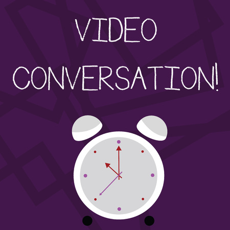 Writing note showing Video Conversation. Business concept for Communicating visually with another demonstrating via computer Colorful Round Analog Two Bell Alarm Desk Clock with Seconds Hand photo
