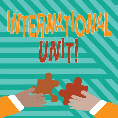 Conceptual hand writing showing International Unit. Concept meaning the internationally accepted amount of a substance Hands Holding Jigsaw Puzzle Pieces about Interlock the Tiles Banco de Imagens