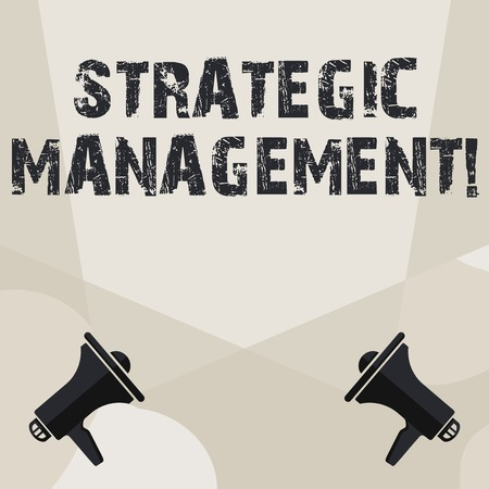 Conceptual hand writing showing Strategic Management. Concept meaning formulation and implementation of the major goals Spotlight Crisscrossing Upward from Megaphones on the Floor Фото со стока