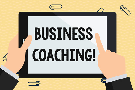 Conceptual hand writing showing Business Coaching. Concept meaning providing support and occasional advice to an individual Hand Holding Pointing Touching Color Tablet White Screen
