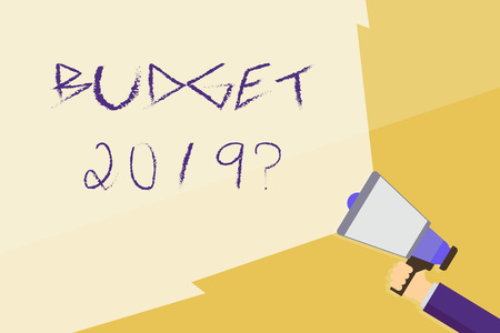 Writing note showing Budget 2019 Question. Business concept for estimate of income and expenditure for next year Hand Holding Megaphone with Beam Extending the Volume Range