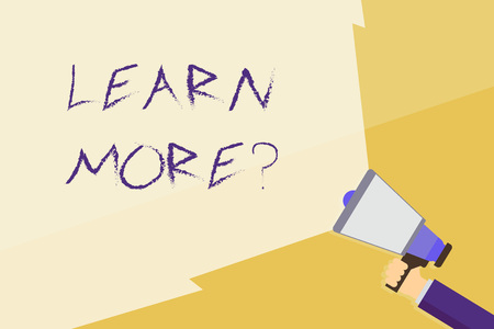 Writing note showing Learn More question. Business concept for gain knowledge or skill studying practicing Hand Holding Megaphone with Beam Extending the Volume Range