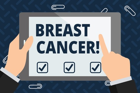 Text sign showing Breast Cancer. Business photo showcasing Malignant tumour arising from the cells of the breast Businessman Hand Holding, Pointing and Touching Colorful Tablet Blank Screen Stock Photo