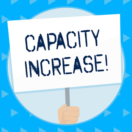 Word writing text Capacity Increase. Business photo showcasing meet an actual increase in deanalysisd, or an anticipated one Hand Holding Blank White Placard Supported by Handle for Social Awareness