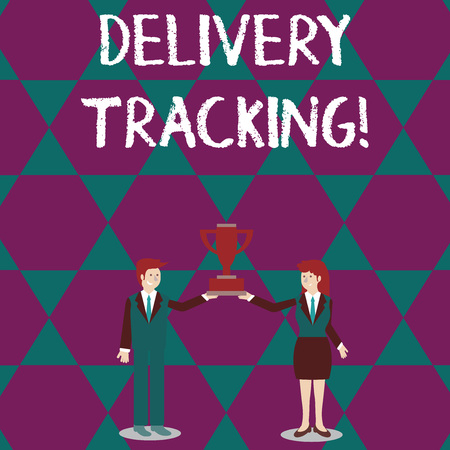 Text sign showing Delivery Tracking. Business photo text the process of localizing shipping containers and mails Man and Woman in Business Suit Holding Together the Championship Trophy Cup