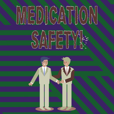 Handwriting text writing Medication Safety. Conceptual photo freedom from preventable harm with medication use Two Businessmen Standing, Smiling and Greeting each other by Handshaking 版權商用圖片