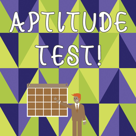 Writing note showing Aptitude Test. Business concept for designed to determine a demonstrating s is ability in a particular skill Businessman Smiling and Pointing Calendar with Star on Wall