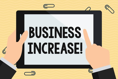 Conceptual hand writing showing Business Increase. Concept meaning improving some measure of an enterprise   is success Hand Holding Pointing Touching Color Tablet White Screen