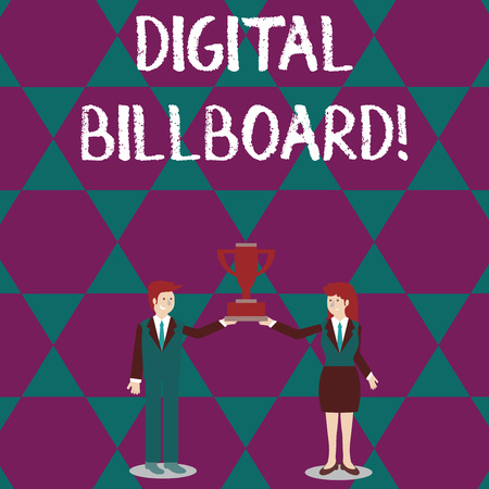 Text sign showing Digital Billboard. Business photo text billboard that displays digital images for advertising Man and Woman in Business Suit Holding Together the Championship Trophy Cup Reklamní fotografie