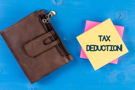 Text sign showing Tax Deduction. Business photo showcasing amount subtracted from income before calculating tax owe