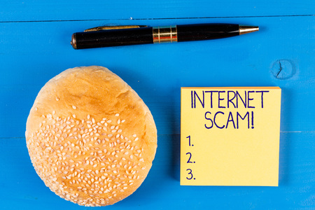 Handwriting text Internet Scam. Conceptual photo type of fraud or scam which makes use of the Internet Imagens