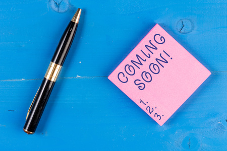 Handwriting text writing Coming Soon. Conceptual photo event or action that will happen after really short time Imagens