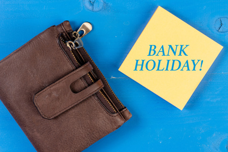 Writing note showing Bank Holiday. Business concept for A day on which banks are officially closed as a public holiday