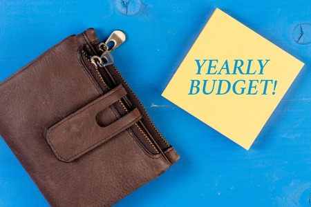 Writing note showing Yearly Budget. Business concept for A plan for a company s is expenditures for a fiscal year