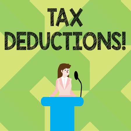 Writing note showing Tax Deductions. Business concept for amount or cost that can be subtracted from someone s is income Businesswoman Behind Podium Rostrum Speaking on Microphone