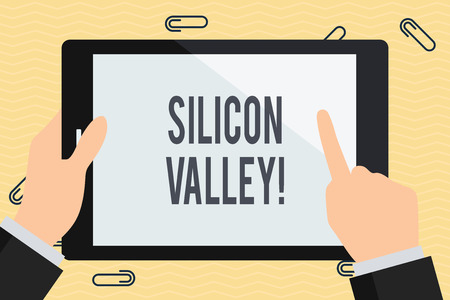 Conceptual hand writing showing Silicon Valley. Concept meaning home to analysisy startup and global technology companies Businessman Hand Holding and Pointing Colorful Tablet Screen