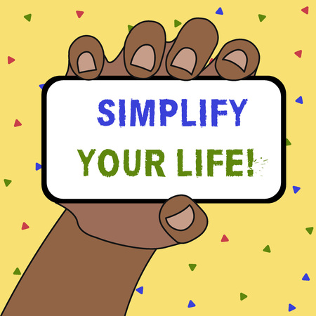 Writing note showing Simplify Your Life. Business concept for focused on important and let someone else worry about less ones Banco de Imagens