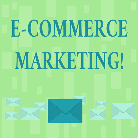 Handwriting text E Commerce Marketing. Conceptual photo business that sells product or service electronically Pastel Color Closed Envelopes in Different Sizes with Big one in the Middle Archivio Fotografico