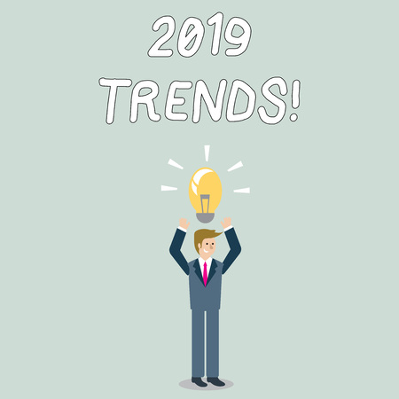Word writing text 2019 Trends. Business photo showcasing general direction in which something is developing or changing Businessman Standing Raising Arms Upward with Lighted Bulb Icon on his Head