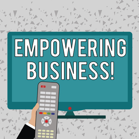 Word writing text Empowering Business. Business photo showcasing creating an environment that fosters growth of business Hand Holding Computer Remote Control infront of Blank Wide Color PC Screen