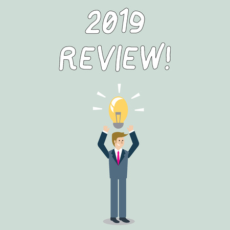 Word writing text 2019 Review. Business photo showcasing remembering past year events main actions or good shows Businessman Standing Raising Arms Upward with Lighted Bulb Icon on his Head Reklamní fotografie