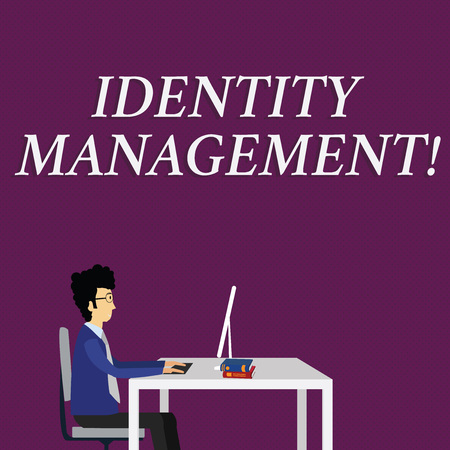 Writing note showing Identity Management. Business concept for administration of individual identities within a system Businessman Sitting on Chair Working on Computer and Books 版權商用圖片