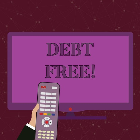 Handwriting text Debt Free. Conceptual photo does not owning any money or things to any individual or companies Hand Holding Computer Remote Control infront of Blank Wide Color PC Screen Stock Photo
