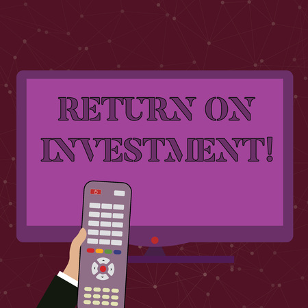 Handwriting text Return On Investment. Conceptual photo perforanalysisce measure used evaluate efficiency of investment Hand Holding Computer Remote Control infront of Blank Wide Color PC Screen