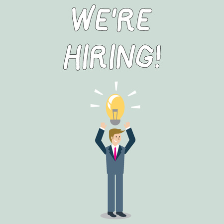 Word writing text We Re Hiring. Business photo showcasing recently employ someone or pay someone to do particular job Businessman Standing Raising Arms Upward with Lighted Bulb Icon on his Head