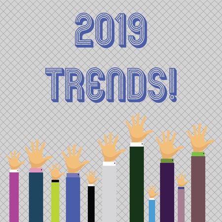 Text sign showing 2019 Trends. Business photo showcasing general direction in which something is developing or changing Hands of Several Businessmen Raising Up Above the Head, Palm Facing Front