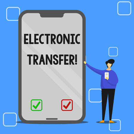 Handwriting text writing Electronic Transfer. Conceptual photo transaction that takes place over a computerized network Man Presenting Huge Blank Screen Smartphone while Holding Another Mobile 免版税图像