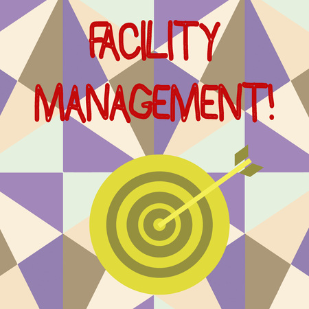 Writing note showing Facility Management. Business concept for maintenance of an organization s is buildings and equipment Dart Board in Concentric Style with Arrow Hitting the Center Bulls Eye