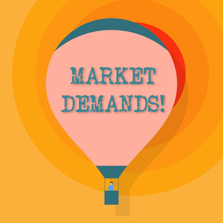 Conceptual hand writing showing Market Demands. Concept meaning Gather facts about situations that affect marketplace Hot Air Balloon Floating with Passenger Waving From Gondola
