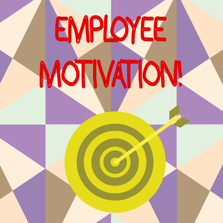 Writing note showing Employee Motivation. Business concept for Energy that a company s is workers bring to their jobs Dart Board in Concentric Style with Arrow Hitting the Center Bulls Eye Фото со стока