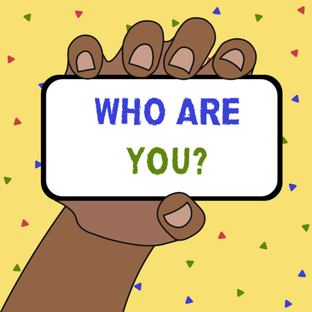 Writing note showing Who Are You Question. Business concept for asking about someone identity or demonstratingal information