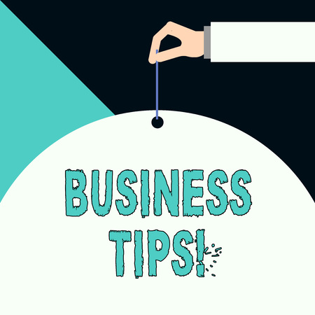Writing note showing Business Tips. Business concept for tricks or ideas on how to start or run a small business 版權商用圖片